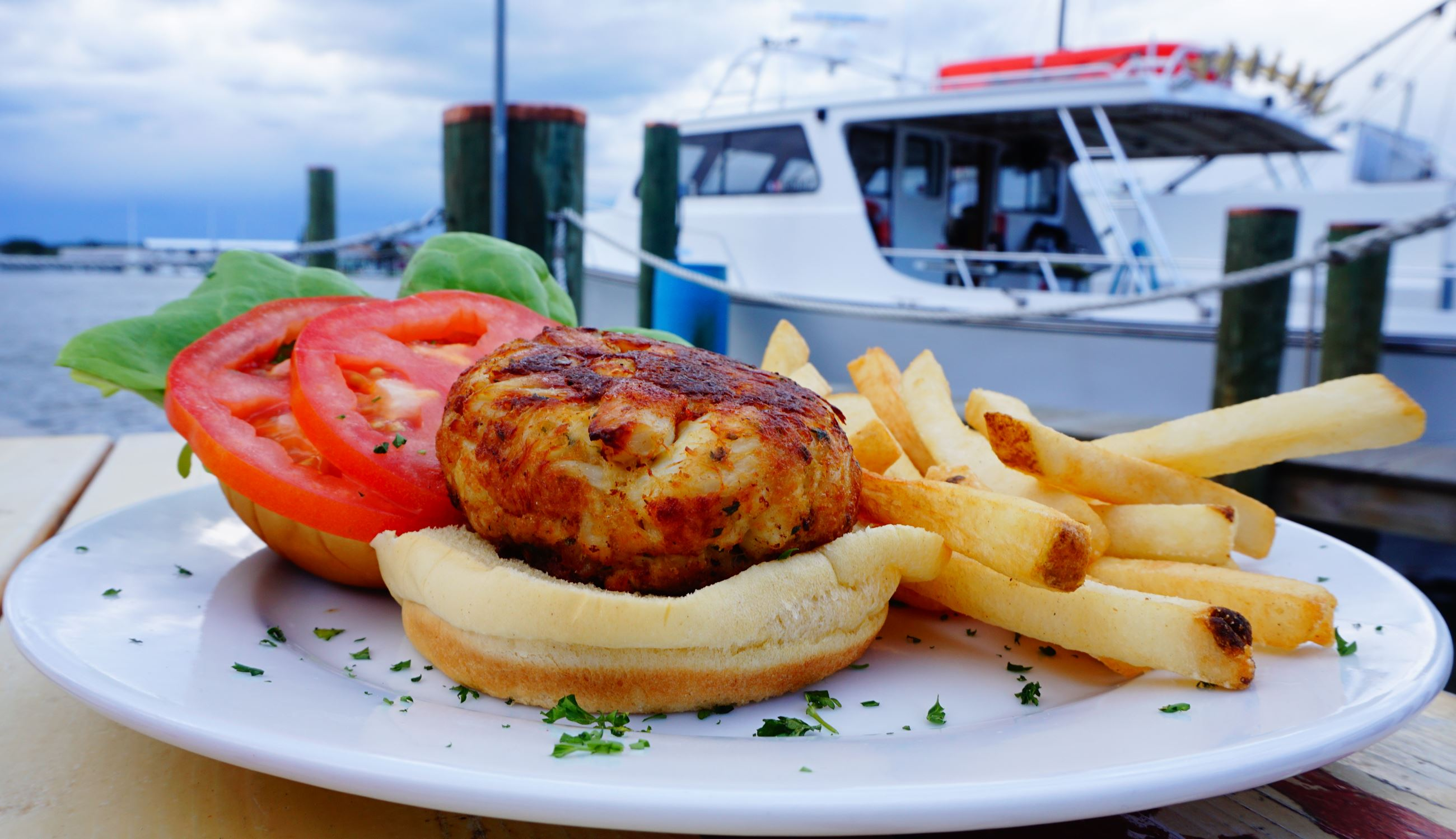 Harris Crabhouse crabcake with boat Brian Suite photo credit